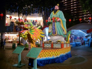 Qu Yuan on a Dragon Boat as depicted in a sculpture in Singapore on display during the Dragon Boat Festival. Photo by Vmenkov