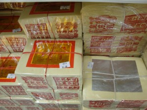 Stacks of ghost money, also called joss paper for sale at a store. Photo by Sjschen